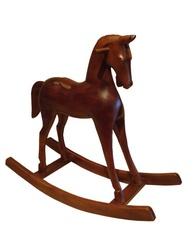 Cheval à bascule en bois sculpté